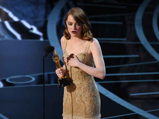 Emma Stone accepts the Oscar for Best Actress for her