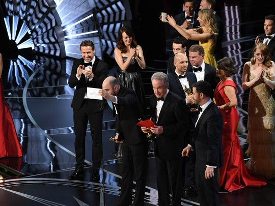 Jordan Horowitz, a producer for 'La La Land,' holds up the card showing 'Moonlight' as the best picture winner.