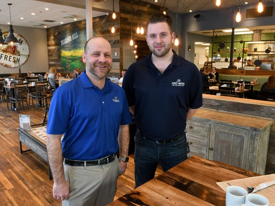 John Bushore, left, area supervisor for First Watch and Joey Kooi, manager of this location in the Bearden Hill location,  Tuesday, Feb. 28, 2017. Capstone Concepts has  transformed several businesses in Knoxville.