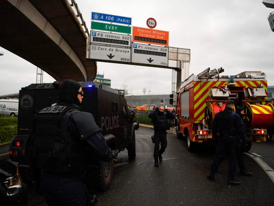 French policemen and firefighters secure the area at