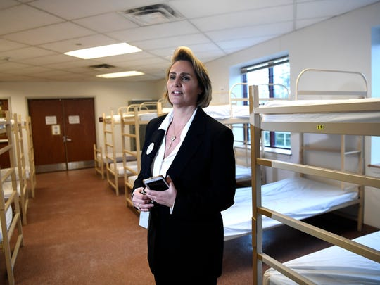 Julia Orlando, director of Bergen County Housing, Health, and Human Service Center, stands in the downstairs sleeping shelter. County Executive James Tedesco announced that Bergen County has become the first county in the nation to eliminate chronic homelessness during a press conference in Hackensack, NJ on Tuesday, March 28, 2017.