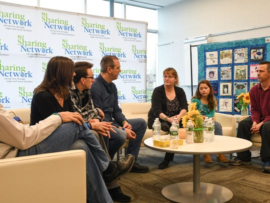 The Bautista and Masse families meet at NJ Sharing Network headquarters in New Providence.