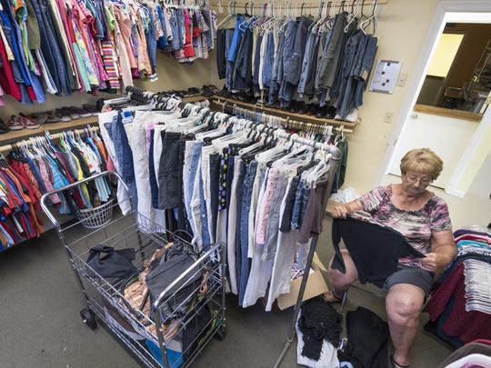 Volunteer Kathy Calaway sorts donated clothing Thursday, April 20, 2017. The Nehemiah Project serves at risk kids through a Christ based after school program and distributes food and clothing.