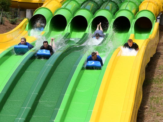 Various media members try out new TailSpin racer water slide at Dollywood Thursday, May 18, 2017.