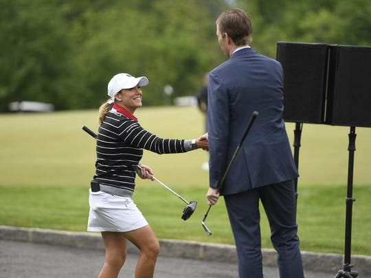 Cristie Kerr shakes hands with Eric Trump while at the Trump National Gulf Club on Wednesday, May 24, 2017. The golf course hosted a media day event on Wednesday ahead of the women's U.S. Open which will take place in July.