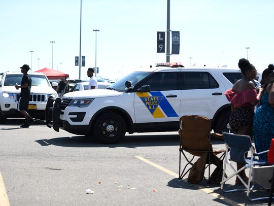 A New Jersey State Trooper patrols through the parking