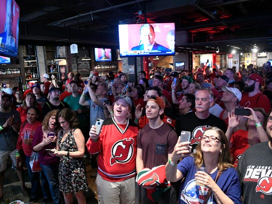 Fans watch as the New Jersey Devils pick Nico Hischier