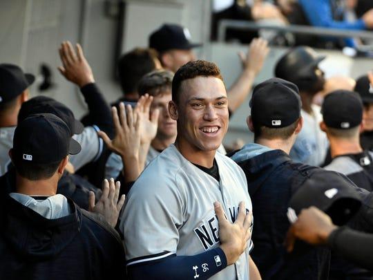 New York Yankees right fielder Aaron Judge (99) smiles