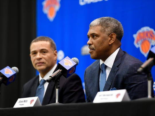New York Knicks president Steve Mills, right, introduces new general manager Scott Perry, left, during a press conference at the Knicks Training Facility in Tarrytown, NY on Monday, July 17, 2017.