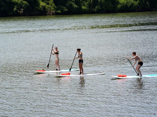 Paddle boarding at Volunteer Landing along Knoxville's downtown waterfront made the 90-degree temperature a bit easier Wednesday, July 19, 2017.