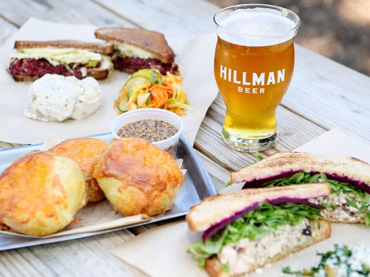 Rise Above Deli's pastrami Reuben, knish and smoked turkey salad sandwich with a Hillman Beer IPA.