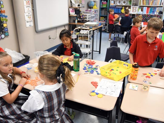 Second grade students work on a class assignment during