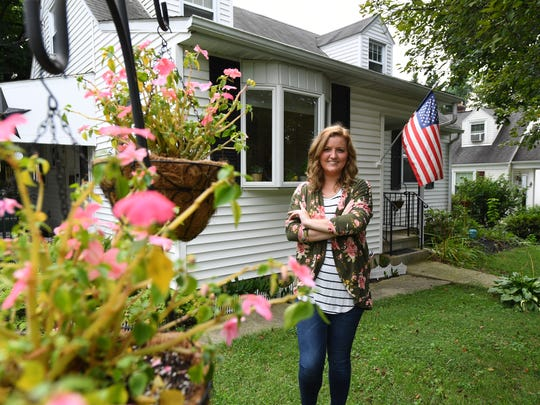 Allentown, PA, U.S.A  -- No place like home: Meagan Walsh, 25, stands in front of her house in Allentown, PA, that she bought with cash she saved after returning home to her parents' house after college.