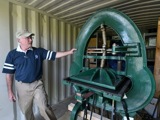 Charlie Rhodarmer shows off an acorn press similar to what was used by Cherokees to print their newspaper, The Phoenix, in 1833. The press will be prominently displayed in the renovation at the Sequoyah Birthplace Museum in Vonore, Wednesday, Aug. 9, 2017.