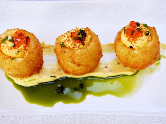 Jargon's deep fried deviled eggs with Lusty Monk mustard aioli, salmon roe and chives.