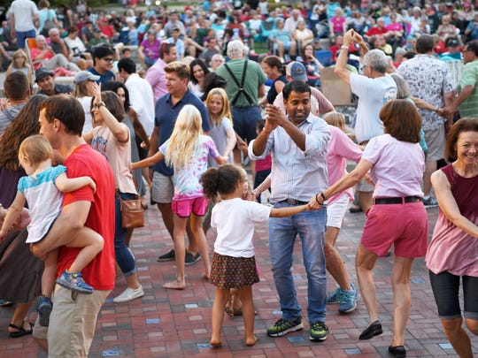 Shindig on the Green audience members are led in dance by Glenn Bannerman at Pack Square Park August 19, 2017.