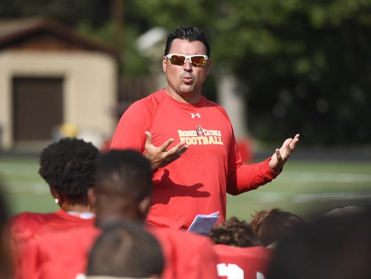 Bergen Catholic head coach Nunzio Campanile talks to