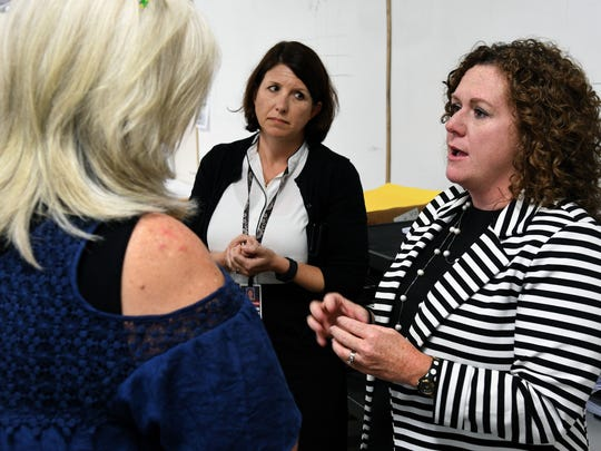 Carter High School principal Angie Messer, right, talks to teacher Cynthia Cupp, left, in her AP Human Geography class Wednesday, Aug. 23, 2017. In back center is Shanno0n Jackson, district executive director of school curriculum. More students took and passed AP tests in Tennessee than ever before last school year.