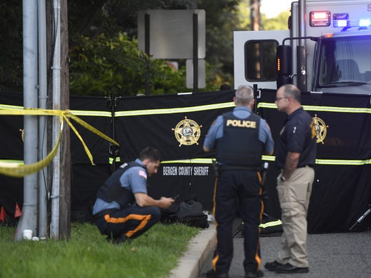 The Bergen County Sheriff's crime scene unit investigates a body that was found in between 600 and 660 Kinderkamack road in Oradell, NJ on Thursday, August 24, 2017.