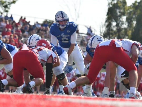 Chase Wolf lines up under center for the St. Xavier