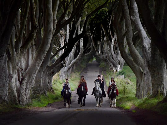 Four actors on horseback dressed in Game of Thrones related costumes carry the Queen's Baton as they make their way way along the Dark Hedges on Aug. 29, 2017, in Antrim, Northern Ireland. The Dark Hedges near Stranocum in County Antrim were featured as the King's Road in season two of 'Game of Thrones' and has become a tourist mecca for fans of the television series along with other filming locations in the province. The Queen's Baton Relay is currently on a tour of the United Kingdom as it makes its way around Europe in preparation for the 2018 Commonwealth Games in Australia.