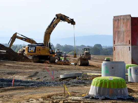 Construction crews grade the site for the new main