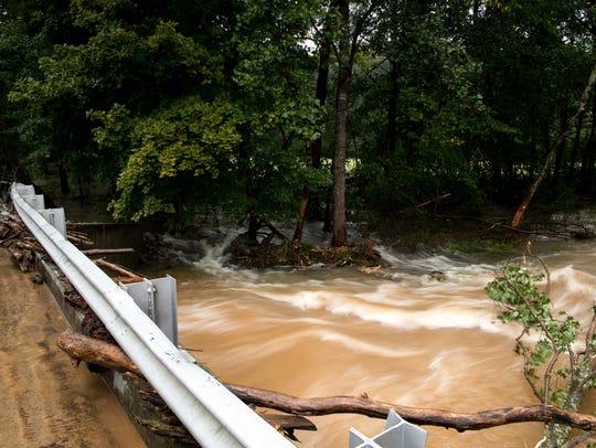 Brush Creek flows rapidly under Edd Ross Road near