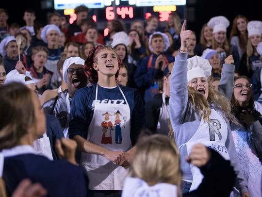 "The Reitz student section cheers for the Panthers at John Lidy Field last year. Reitz fans refer to Castle as ""Cake eaters""."