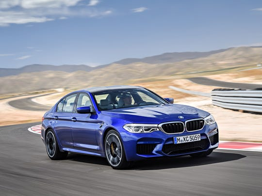 BMW is also showing the first-ever all-wheel-drive car from its legendary M Sport performance brand. The 2018 M5 midsize sport sedan features a 600-hp 4.4L twin-turbo V8 and 8-speed automatic transmission.