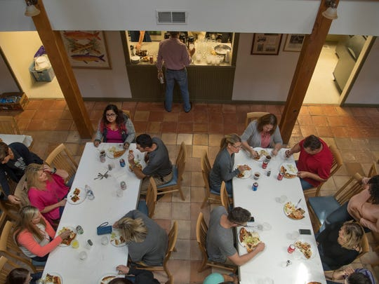 Participants in Leadership Evansville's annual retreat gather for lunch at the Barn Abbey in New Harmony, Ind., in August.