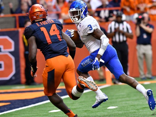 Sep 9, 2017; Syracuse, NY, USA; Middle Tennessee Blue Raiders wide receiver Richie James (3) beats Syracuse Orange defensive back Evan Foster (14) on a passcatch to score a touchdown during the third quarter of a game at the Carrier Dome.