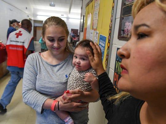 Jesenia Zapata, right, of Bonita Springs, Florida touches