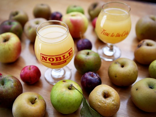 Types of heritage apples on the bar with glasses of