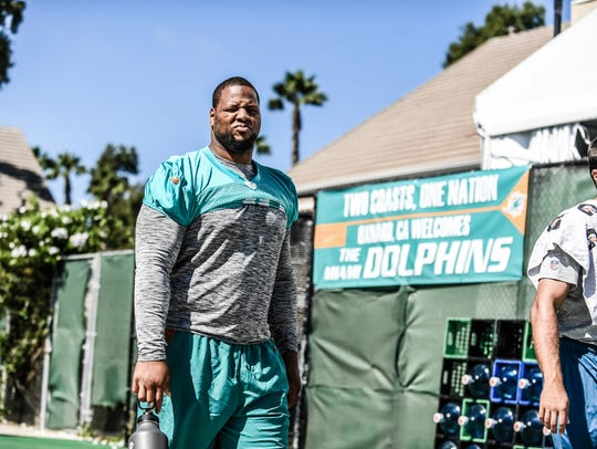 Defensive tackle Ndamukong Suh walks to practice in