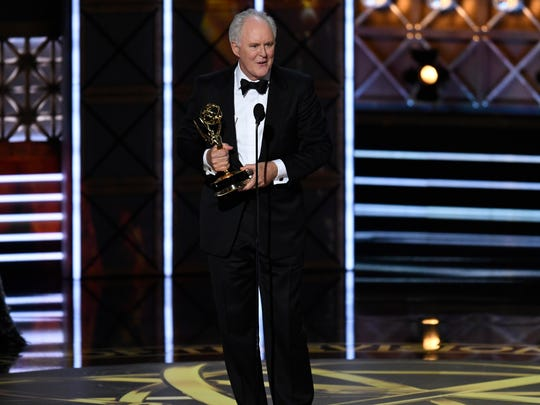 John Lithgow accepts the award for supporting actor