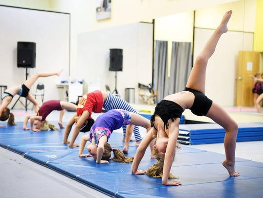 Acrobats students do backbends at Center Stage Dance