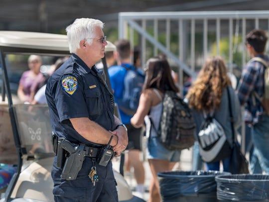 Visalia Police Officer Rob Zieg watches students on