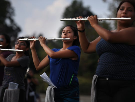 Julie Vazquez, 17, center, playing the flute with the