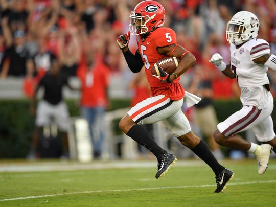 Sep 23, 2017; Athens, GA, USA; Georgia Bulldogs wide receiver Terry Godwin (5) runs for a touchdown past Mississippi State Bulldogs defensive back Tolando Cleveland (7) during the first quarter at Sanford Stadium. Mandatory Credit: Dale Zanine-USA TODAY Sports