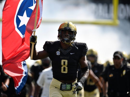 Vanderbilt cornerback Joejuan Williams (8) waves the