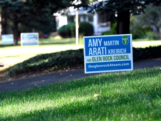 Signs in support of council candidates Amy Martin and