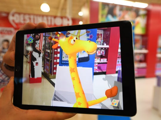 An exclusive peek at the toy store's new augmented reality in-store experience.  The experience will allow shoppers, through their mobile devices, to be guided to experience zones in the store by the chain's mascot Geoffrey. It's another example of the innovations retailers are introducing to entice shoppers to push away from the keyboard, and visit an actual store. -- Photo by Robert Deutsch, USA TODAY