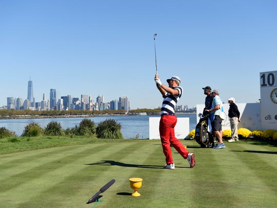 Kevin Chappell of the United States tees off at hole 10 in the final round of the Presidents Cup at the Liberty National Golf Club in Jersey City, NJ on Sunday, October 1, 2017.