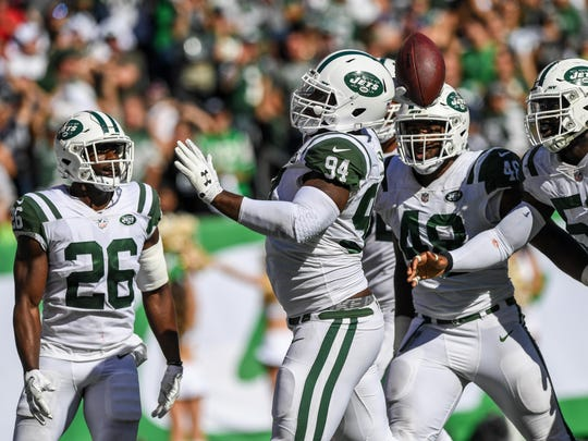 Oct 1, 2017; East Rutherford, NJ, USA; New York Jets outside linebacker Kony Ealy (94) throws the ball into the crowd in celebration of his interception during the 3rd quarter at MetLife Stadium. Mandatory Credit: Dennis Schneidler-USA TODAY Sports