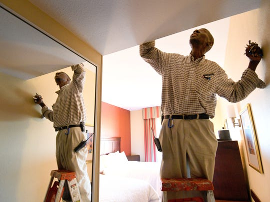 Fred Ipaye, who is from Nigeria and works maintenance for the Hampton Inn West Knoxville, does a monthly fire alarm check in a room  Friday, Oct. 6, 2017. Ipaye has been in Knoxville since 1974.