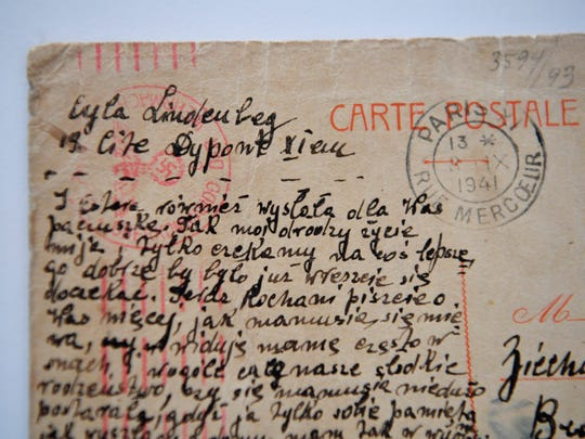 A postcard sent from Holocaust survivor Frances Cutler Hahn's mother to other family members has the swastik on the postmark sent from an occupied Paris during WWII.Friday Oct. 6, 2017, in Nashville, TN