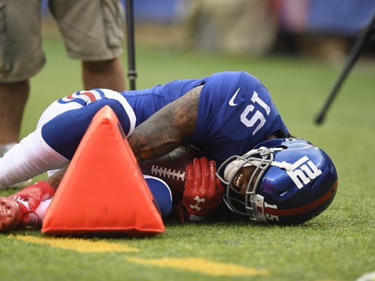 New York Giants wide receiver Brandon Marshall #15 grabs his left ankle as he lays on the sideline in the first half. The Los Angeles Chargers lead the Giants 10-9 in the first half on Sunday, October 8, 2017 in East Rutherford, NJ.