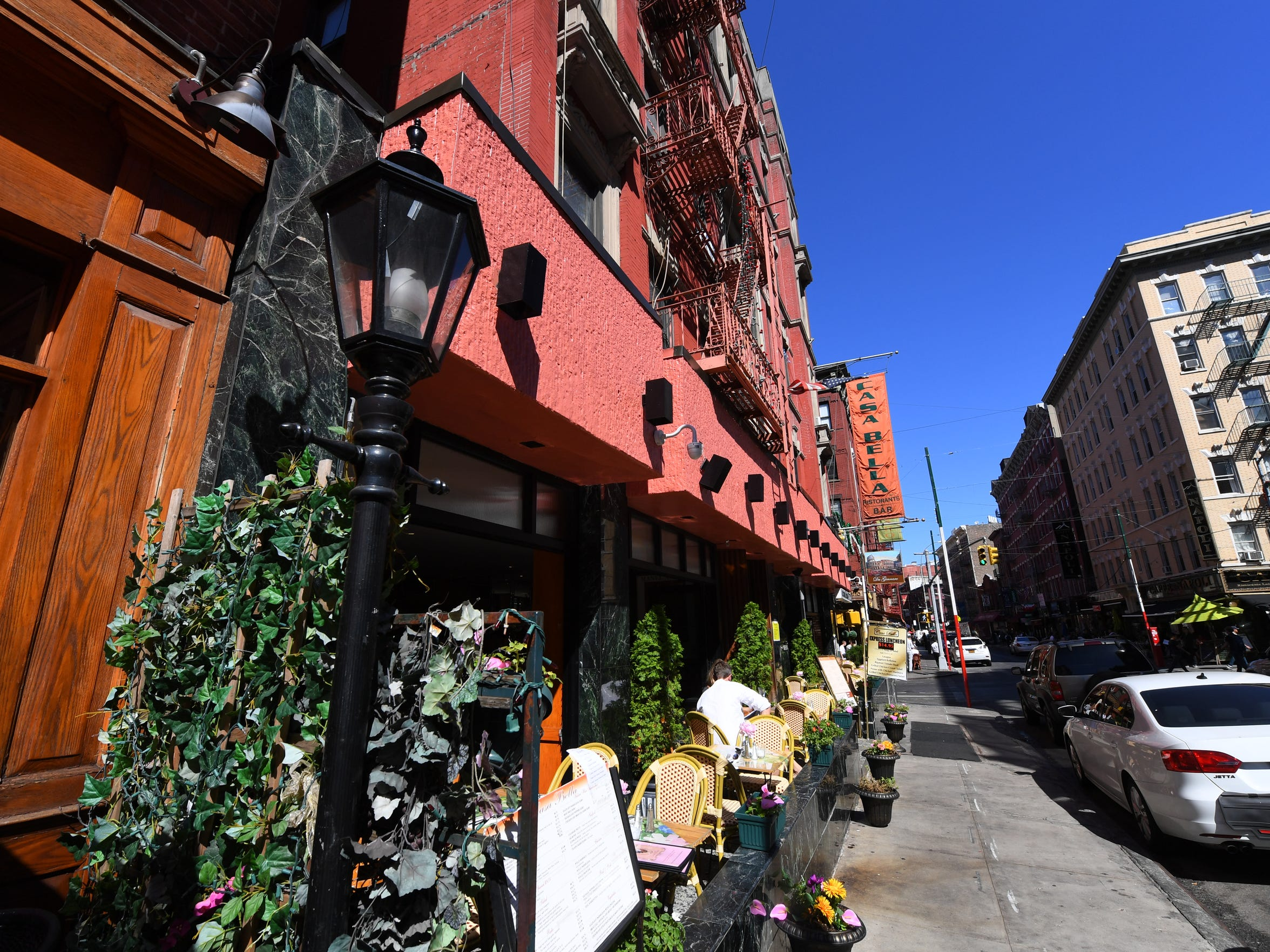 Diners enjoy a meal on Mulberry Street in New York's