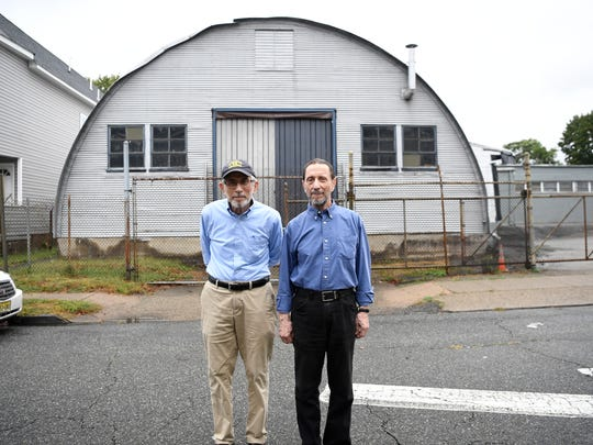 Business owners Abe Levine, left, and Lewis Neuman in front of their factory in Garfield.