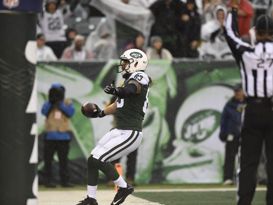 New York Jets tight end Eric Tomlinson (83) celebrates
